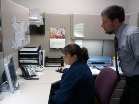 Joannah Branch and Darrell Estes at Northern Hospital in Mount Airy check the latest emails they've received from secondary wholesalers.