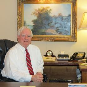 Parks Helms at his office in uptown Charlotte. He was chairman of the Mecklenburg County Commission and served more than a decade in the House as a state representative.
