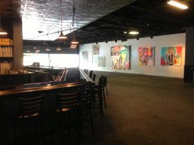 The new bar area feels more open and features local art on the walls.