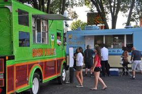 Charlotte food trucks gather for Chow Down Uptown across Seventh Street from Levine Museum.