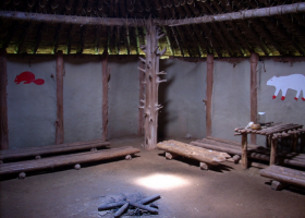 The interior of the ceremonial center at the top of the mound. The sacred fire burned in the center and tribes sat on logs on each side of the hut under the symbols representing their clan within the tribe.