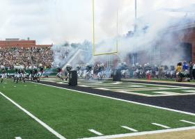 The UNC-Charlotte 49ers enter Jerry Richardson stadium for their first-ever game.