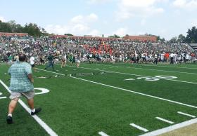 Students rushed the field after the game.