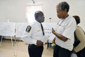 Chief Rodney Monroe, right, and Capt. Rob Dance talk with Doris Edwards, a member of the Hidden Valley community.