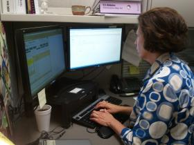 Johanna Wilson sits in her cubicle at Elizabeth Family Medicine in Charlotte.