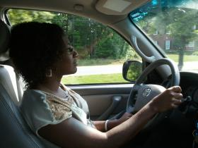 Larri Diggs-Jones drives her SUV to visit a patient.