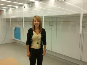 Pat Stephens stands in front of workspaces in the clean room she had to redesign as she's trying to meet FDA standards.