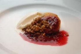 'Country Cobbler' of Sweet Potato Sponge Cake, Pecan Cinnamon Streusel, Muscadine-Summer Berry Compote and Tripple C Smoked Amber Ice Cream prepared by Chef Nicolas Daniels of The Wooden Vine.