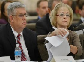 Mark Payne, Chief Compliance Officer at North Carolina Department of Health and Human Services and DHHS Secretary Aldona Wos answer questions during a day-long hearing at the Legislative Office Building in Raleigh on Tuesday.