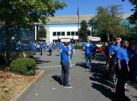 Employees gather outside at the opening of Yodle's new offices in Charlotte.