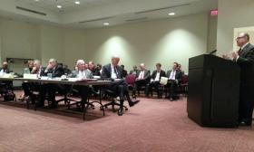 Charlotte city manager Ron Carlee (right) addresses the Charlotte Airport Commission, including lawyers Martin Brackett and Richard Vinroot (at end of table), and executive director Jerry Orr. City officials have sued the commission, are facing Vinroot and Brackett in court, and ousted Orr from his previous post as Charlotte aviation director. City lawmakers also appointed most of the commission.