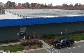The city's largest solar project to date, 250 kW, rests on top of the CLT Center.