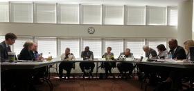 MeckLINK commissioners (center table) Vilma Leake, Trevor Fuller, Karen Bentley, and Bill James meet with Cardinal Innovations leadership (left table).