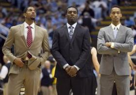 UNC players Leslie McDonald, P.J. Hairston and J.P. Tokoto watch their teammates warm up for Friday's exhibition basketball game against UNC Pembroke at the Smith Center in Chapel Hill. Hairston and McDonald are sitting out as UNC works with the NCAA to resolve eligibility issues. Tokoto is sitting out for not filing the proper paperwork after playing in a summer league.
