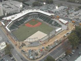 Workers install sod at BB&T Ballpark in uptown Charlotte on November 5, 2013.