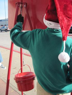 A volunteer collects money for Salvation Army.