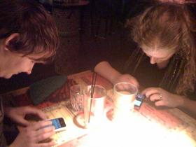 Texting in a bar.