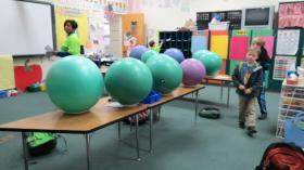Students come in and unpack before class begins. The stability balls are kept in place with paper plates.
