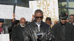 The Rev. Billy Grier led the prayer outside the government center on Monday morning.