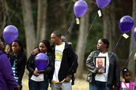 Friends and family of Cedric Miller gather during a Mothers of Murdered Offspring vigil at Frazier Park Wednesday, January 1, 2014. 43-year-old Miller was shot and killed July 14, 2013.