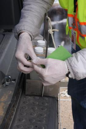 Scientists collect water samples from the Dan River following a coal ash spill from a retired Duke Energy plant.