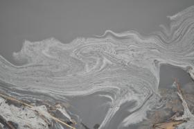 A plume of coal ash swirls in the Dan River, during the February spill.