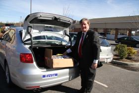 Judge and candidate Sam Ervin stands at his trunk.