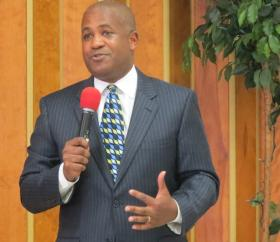 Candidate Vince Coakley, one of two Republicans in the race, advocated for smaller government during a candidate forum on April 3, 2014 at Little Rock A.M.E. Zion Church.