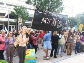 Protesters chanted outside the Duke Energy corporate headquarters in Uptown.