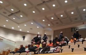 City utility and sanitation workers file into the city council meeting to hear the city manager's recommended budget.