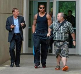 Carolina Panther Greg Hardy, middle, leaves the Mecklenburg County Jail.