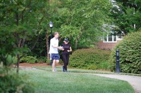 WFAE's Duncan McFadyen jogs along with 91 year-old Harriette Thompson near her Charlotte home.