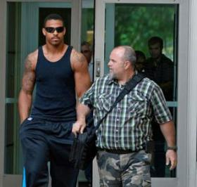 Carolina Panthers' Greg Hardy exits the Mecklenburg County Jail after his bond was set at $15,000 for assault and $2,000 for threats. Hardy was also told he can't contact the accuser and he must attend three Alcoholics Anonymous meetings each week.