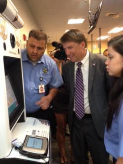 Governor Pat McCrory checks out a self-serve kiosk at a new DMV office in Huntersville. Starting May 1, the written exam is no longer required for licensed drivers.