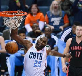 Charlotte Bobcats center Al Jefferson (25) throws down a one-handed dunk.