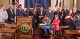Gov. McCrory at the bill signing to finalize the basic rules for the partial privatization of the Commerce Department.