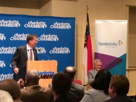 Governor Pat McCrory shares a laugh with Sealed Air CEO Jerome Peribere.