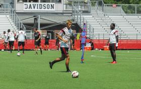 Keisuke Honda dribbles at Davidson College's Alumni Field as his Italian professional team AC Milan practiced Monday.