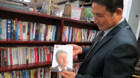 Ki-Hyun Chun shows off a book about Bill Clinton translated to Chinese.