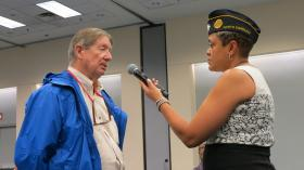 Verna Jones, staff director at the American Legion office in Washington, D.C. moderated the town hall meeting on Monday night at the Charlotte Convention Center. Jones holds the microphone for William Hinson.