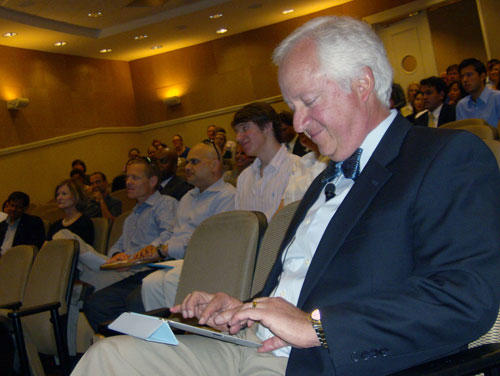 Fernando Aguirre, perhaps Tweeting, before addressing students at Queens University. Photo: Julie Rose