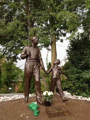 Flowers have been placed at the statue outside the Andy Griffith Playhouse in Mount Airy, NC. Photo: Tanner Latham