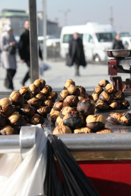 Roasted chestnuts stacked up waiting to be sold