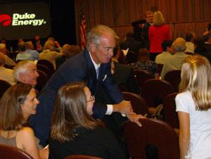 Jim Rogers speaks with attendees at Duke Energy's annual shareholder meeting in May. Photo: Julie Rose.