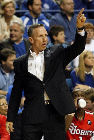 St. John's interim head coach Mike Dunlap directs his team during the first half of an NCAA college basketball game won 81-59 by
