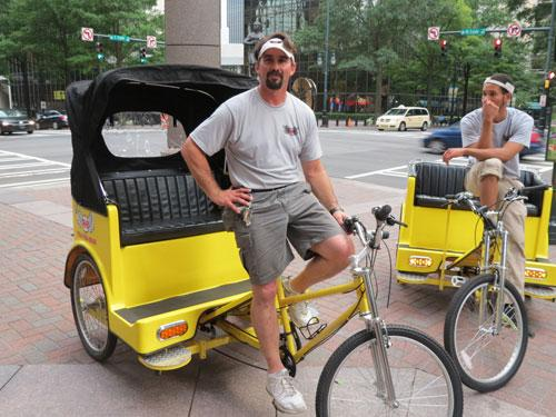 Thomas Richards and is pedicab at Trade and Tryon, Uptown Charlotte. Photo: Marshall Terry.