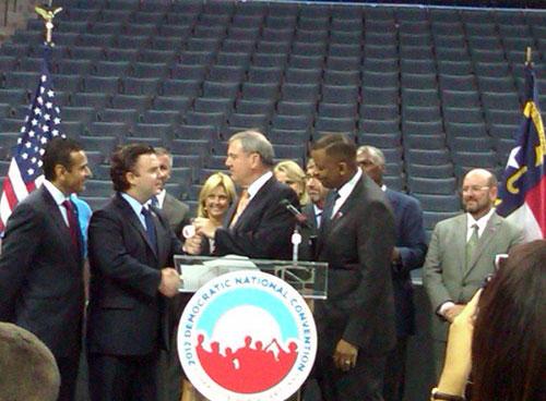 Bobcats EVP Bill Duffy hands TWC Arena keys to DNCC CEO Steve Kerrigan. Photo: Julie Rose