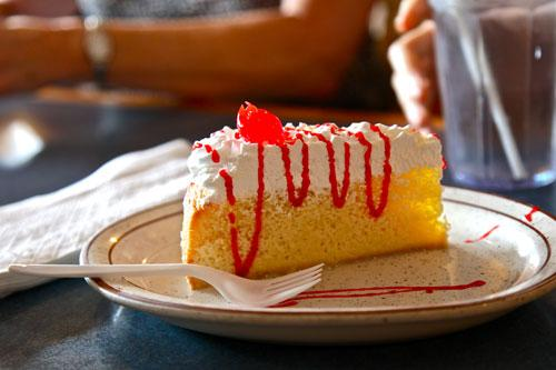 A slice of tres leches cake from El Purgarcito.