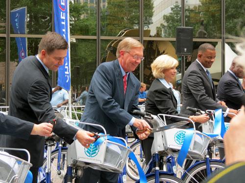 Ribbon cutting for B-cycle, a bike sharing program. Photo: Kalie McMonagle.