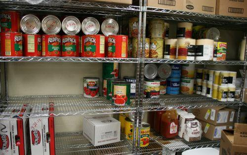Cafeteria food storage. Tomato sauce, beans, hot sauce, grits among some of the regular stock.